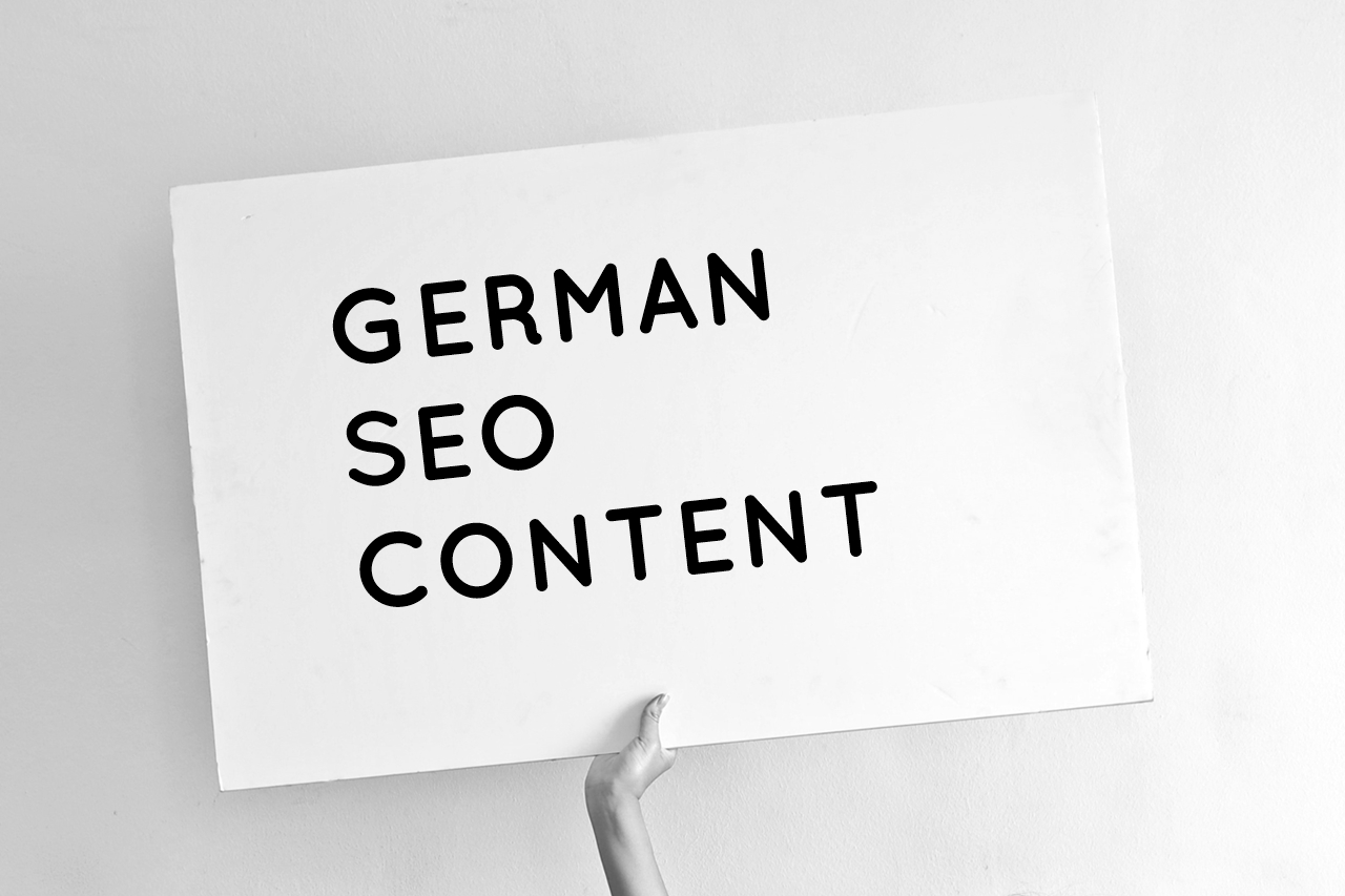 """Hand holding a sign saying """"German SEO Content"""""""